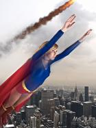 Supergirl flying over NYC